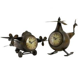 Set of two metal clocks with retro-style airplane silhouettes.    Product: Airplane and helicopter clock setConstruction Material: Metal and glassColor: Antiqued nickelFeatures:  Whimsical airplane and helicopter facesVintage style Dimensions: Airplane: 6.25 H x 5 W x 10.5 D     Helicopter: 9.25 H x 11.75 W x 11.5 D