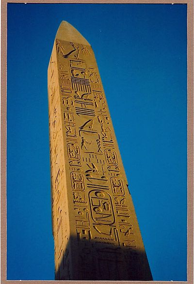 """An obelisk is a tall, four-sided, narrow tapering monument which ends in a pyramid-like shape at the top. These were originally called """"tekhenu"""" by the builders, the Ancient Egyptians. It was a symbol of natural authority and contained written records. http://en.wikipedia.org/wiki/Obelisk"""