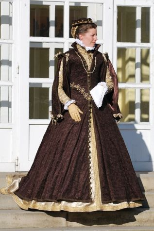 Anna of Austria - Galerilla  The resource for this Spanish court clothing is queen Anna`s portrait by Anthonis Mor made in 1570. The pattern of brown galerilla is based on R. Burgen drawing, the round sleeves are inspired by J.Alcga. The shape of decorative ribbon on the sleeve outer side are based on the decoration of Marketa Frantiska Lobkovicz cloak.    Part of the clothing is small hat and golden hairnet. Under galerilla is golden sateen doublet and golden skirt. Next layer are two black…