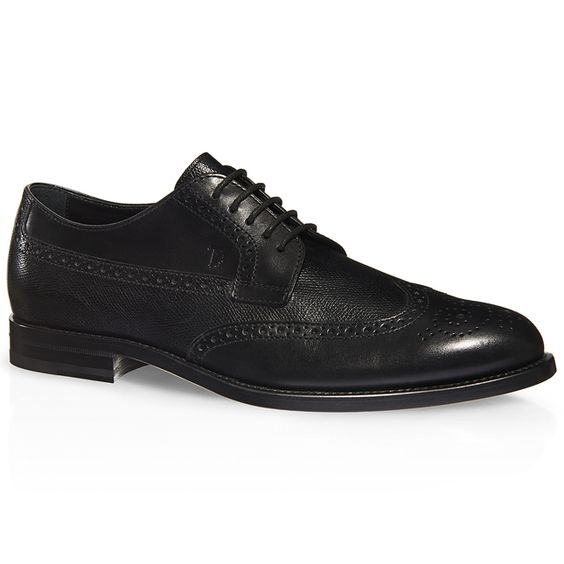 Lace-up shoes crafted in elegant tumbled leather with traditional English-style wingtip perforations, leather outsole and rubber-paneled heel.