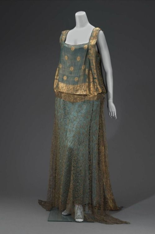 Evening dress, made in the United States in the first quarter of the 20th century (source). This dress, which was owned by Abby Aldrich Rockefeller, incorporates an Indian sari in the bodice front and train. Lovely.
