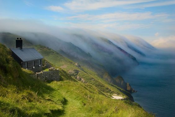 Stunning view of sea mist over the cliffs at Hanmers on Lundy, North Devon, England, UK by the Landmark Trust