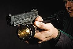 Using a Tactical flashlight by Richard A. Smith, Director The Firearms Training Academy Toll Free 1-855-USA-Armed (872-2763) One of the...