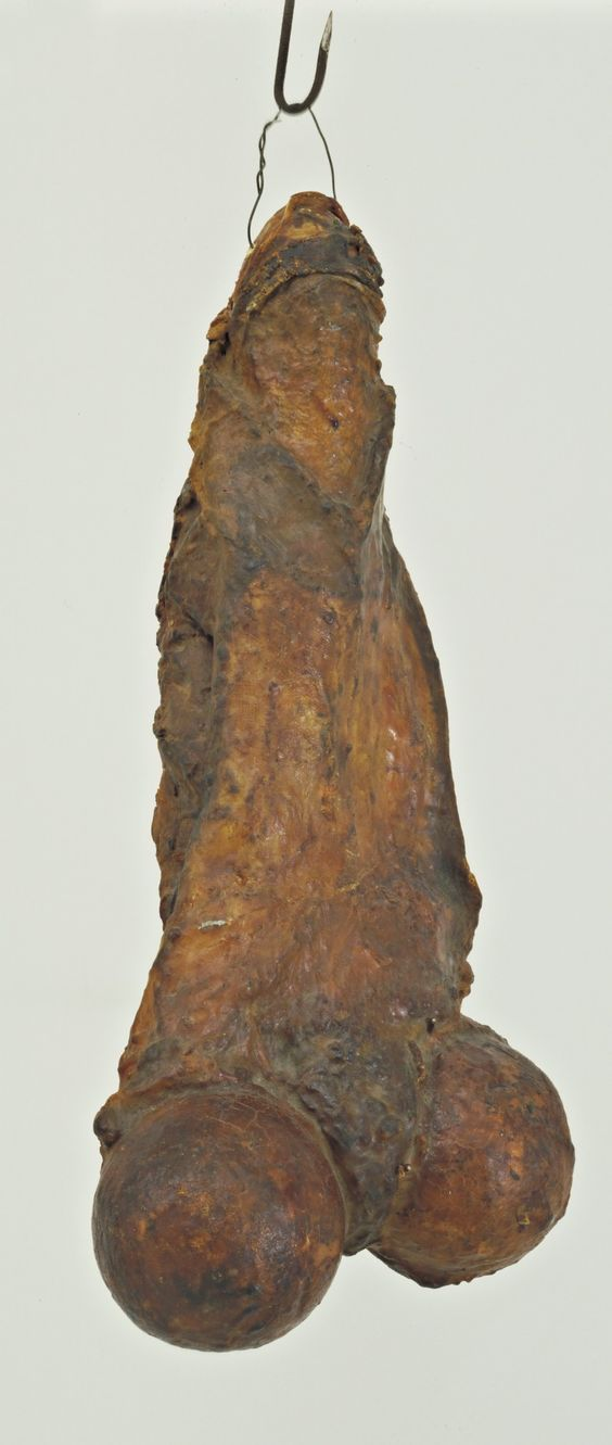 """By layering latex over plaster, Bourgeois achieved a fleshy, tactile texture in this hanging sculpture. While it most obviously represents a phallus, the work can also be seen as a female torso, as the title suggests; in this reading, the two round forms are the tops of two legs, attaching to their hip joints. This eliding of genders creates ambiguity, as do the work's dual qualities of erect potency and fragile vulnerability. """"From a sexual point of view,"""" Bourgeois said, """"I c..."""