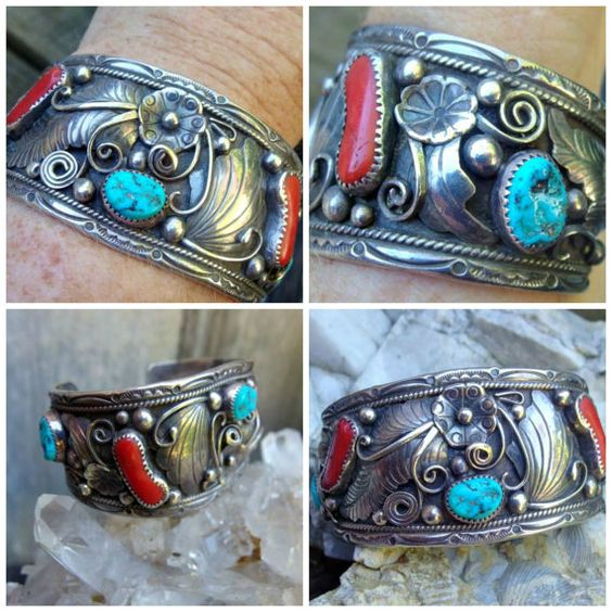 This is a very handsome Southwestern Native American silver, coral and turquoise cuff bracelet. The piece has 3 oval pieces of turquoise and 2