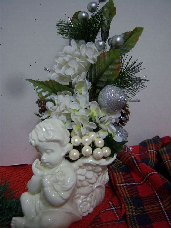 Shiny Cherub Holiday Christmas Floral Arrangement. $18.00, via Etsy. This is the most beautiful angel planter I have ever found. The detail is very deep and so exquisite all over. Just check out the wings......aren't they fantastic!!! The back side has just as beautiful detail with leaf branches and floral.