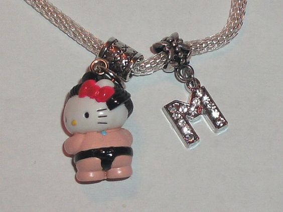 custom hello kitty Pandora style charm bracelet by cupcakegangster, $8.00