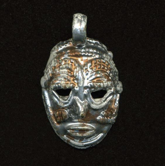Vintage 50mm Enameled Brass Tribal Mask Pendant White, Silver & Copper by beadbrats on Etsy https://www.etsy.com/listing/164222276/vintage-50mm-enameled-brass-tribal-mask