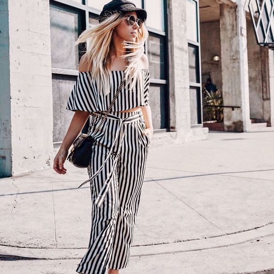 @whitneybearr all in stripes wearing the Amuse Society Voodoo Striped Trousers & Total Flirt Striped Crop Top Head to HERboutique.com to shop this outfit or tap the link in our bio! #HERboutique