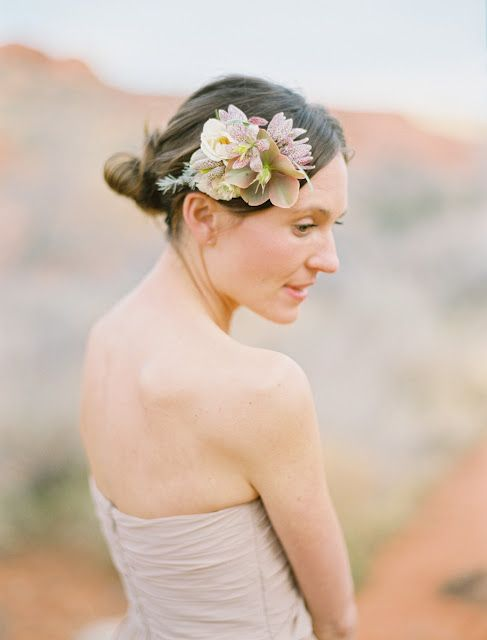 A pretty hair arrangement for a desert wedding...but would it stay in my hair? Probably not!