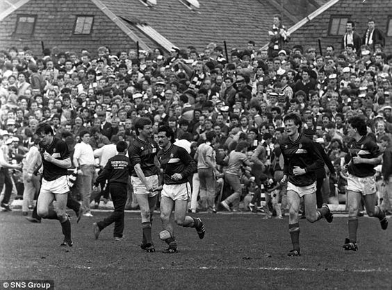 Hearts fans look on stunned as Albert Kidd celebrates his strike for Dundee on the final day of the 1985-86 season.