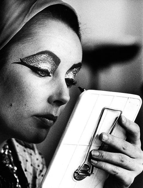 Ms. Taylor touches up her makeup on the set of Cleopatra (1963)