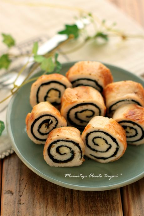 Thin chicken slice layered with roasted seaweed sheets, spiral wrapped around a cheese stick and pan fried. Sliced like sushi.