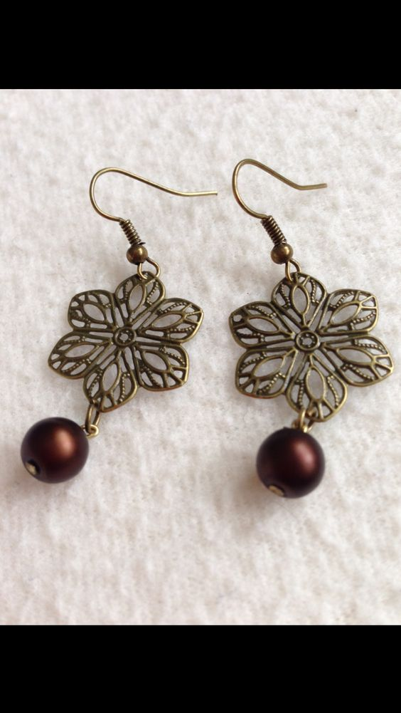 bronze gold filigree earrings with a dark brown pearl drop