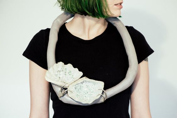 Moniek Schrijer - neckpiece / Concrete, steel, clay, clamshell, glass, silver plaited forks, paint / 2012: