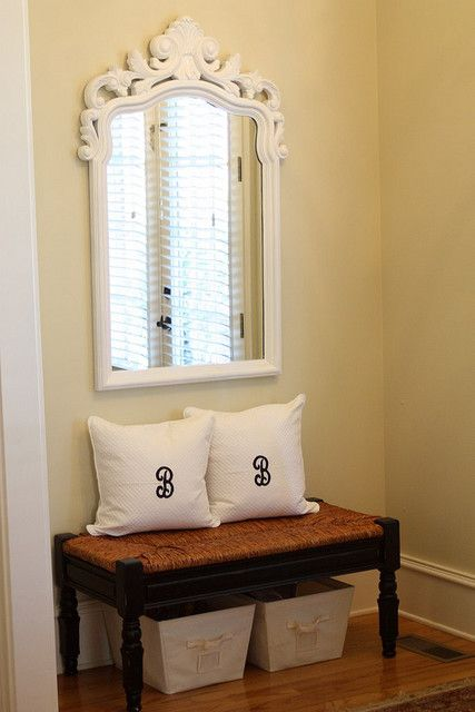 Entryway small bench with cute pillows and storage tubs for Foyer seating area ideas