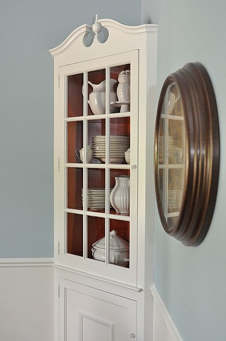 Painted white cabinet hutches with burnt orange insides