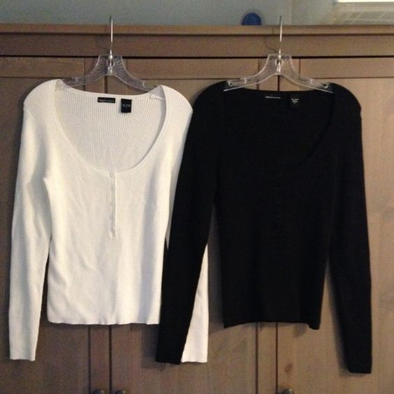 2 VictoriasSecret cable knit tops 2 Victoria's Secret cable knit tops. Scoop neck, long sleeves. One is black, second is winter white. 25 inches in length. Victoria's Secret Tops