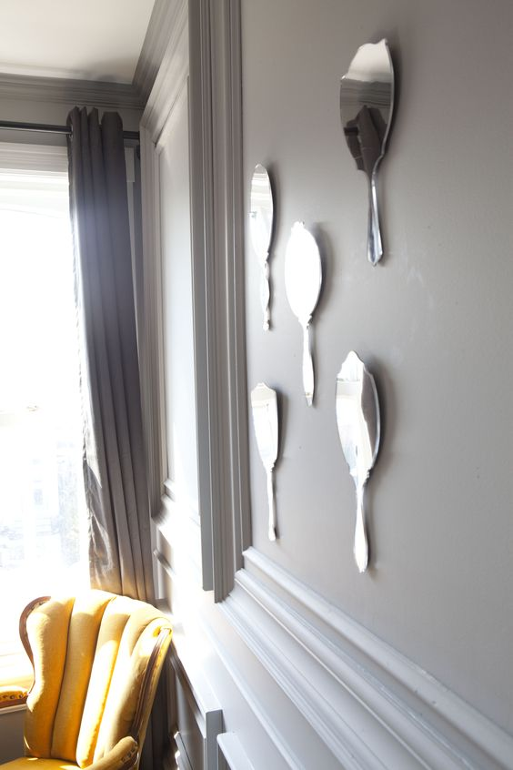 fairest Mirror Wall   Set of 5 antique-looking mirrors with sawtooth hangers gives new meaning to decorative wall pieces. DESIGN BY Mauricio Alfonso // UMBRA (C) 2012