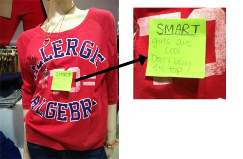 """Shirt says""""Allergic toAlgebra"""" has a sticky note on it that says, """"Smart Girls are cool. Don't buy this top."""""""