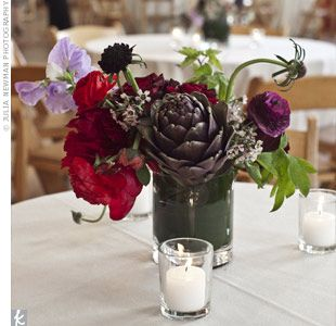 artichokes, ranunculus, sweet peas, scabiosa, and wax flowers