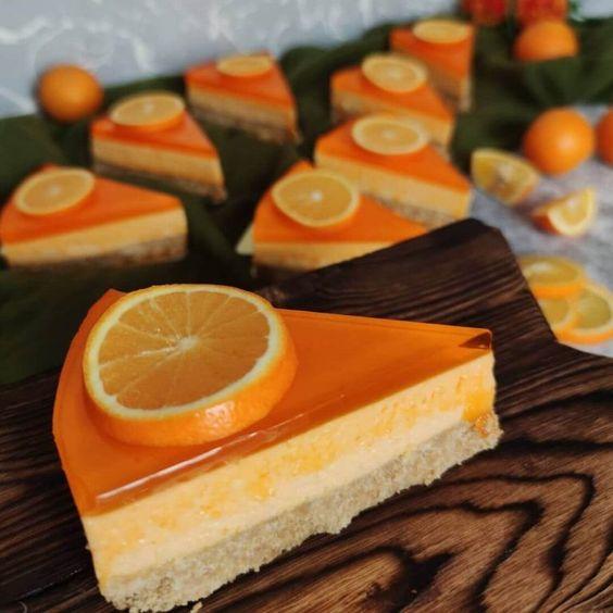 طرز تهیه چیزکیک پرتقالی یخچالی بدون فر و قالب کمربندی با بیسکویت پتی بور In 2021 Orange Cheesecake Recipes Cheesecake Recipes My Recipes
