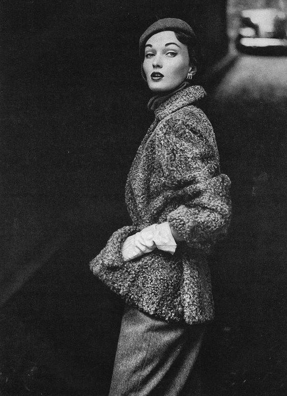 August Vogue 1949 Eve is wearing a natural gray Persian lamb jacket and white lambskin gloves. Photo by Frances McLaughlin-Gill.: