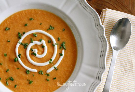 Skinny Yet Creamy Carrot Ginger Soup - I'm not a huge fan of cooked carrots, but when combined with ginger, sour cream and sauteed onions then blended I really enjoy this soup.