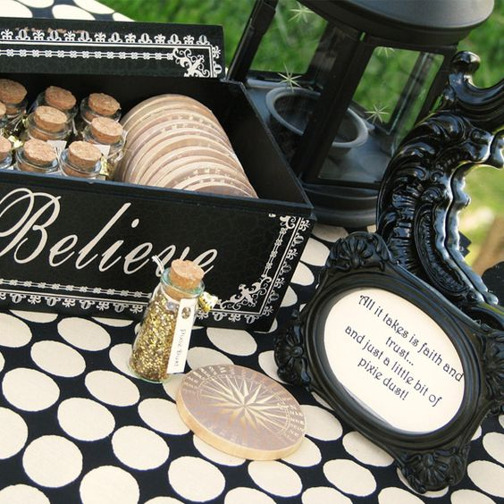 Holy freakin' crap...follow the link to a crazy amazing Neverland themed birthday party....like the fairy dust idea for a Disney themed wedding though...