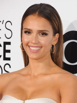 Make a straight and smooth style like Jessica Alba's stand out by tucking both sides behind your ears.