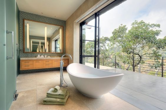 contemporary bathroom by De Meza + Architecture in Sonoma, CA. Love that HUGE expanse of windows that open up to the view. also the freestanding vanity.