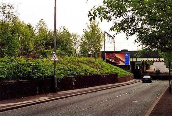 What was the entrance to Longsight Railway Station on Kirkmanshulme Lane. Over Grown ( 2014 )