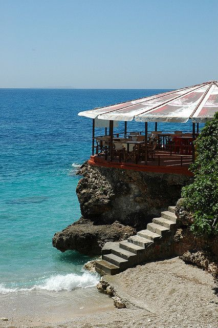 Terrace on the beach in southern Albania (by jontal12) Albania Travel Destinations | Albania Honeymoon | Backpack Albania | Backpacking Albania | Albania Vacation | Albania Photography #travel #honeymoon #vacation #backpacking #budgettravel #offthebeatenpath #bucketlist #wanderlust #Albania #Europe #visitAlbania #TravelAlbania  #AlbaniaTravel