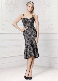 A classic silhouette enhanced with feminine lace detail, brings a chic finish to this elegant mermaid dress!  Bonded lace mermaid dress with sweetheart neckline features eye-catching geometric satin seaming.  Sizes 0-14. Available in Black/Taupe.  Fully lined. Center back zip. Imported polyester. Dry clean only.  To protect your dress, try our Non Woven Garment Bag.