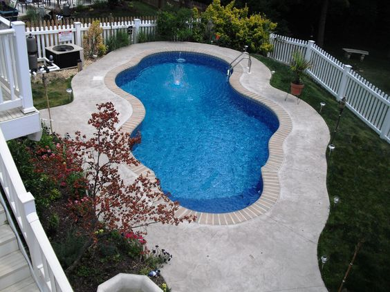 Freeform With Brick Coping And Stamp Concrete Patio Our Beautiful Swimming Pools Pinterest