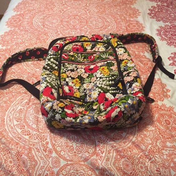 Vera Bradley Laptop Backpack PRICE DROP Vera Bradley backpack with 3 separate pockets, one with a padded laptop sleeve. Looks brand new! Includes Vera Bradley coin purse for FREE Vera Bradley Bags Backpacks