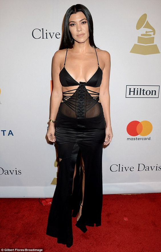 Oh la la: Kourtney Kardashian made a very daring fashion statement at the annual Clive Davis pre-Grammy party in Beverly Hills on Saturday: