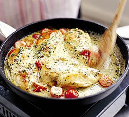 Chicken with cherry tomatoes in a pesto cream sauce - My husband made this for me and it was delicious! We used cream instead of crème fraîche because that's what we had in the fridge