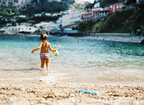 Can't wait to get a cute photo of my kids like this!  Capri + Cute little girl playing in the water = perfection