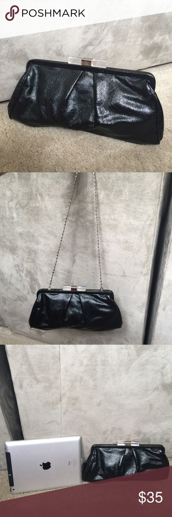 "Black Clutch cross body Lovely black clutch by Chinese Laundry. I believe it is faux leather and not real leather. Has a chain strap that allows it to be worn both as a clutch and as a cross-body or on the shoulder. Strap is approximately 18.5"" long. Features a clear and silver clasp closure. Good used condition.  Good for casual or cocktail wear. Bags Crossbody Bags"