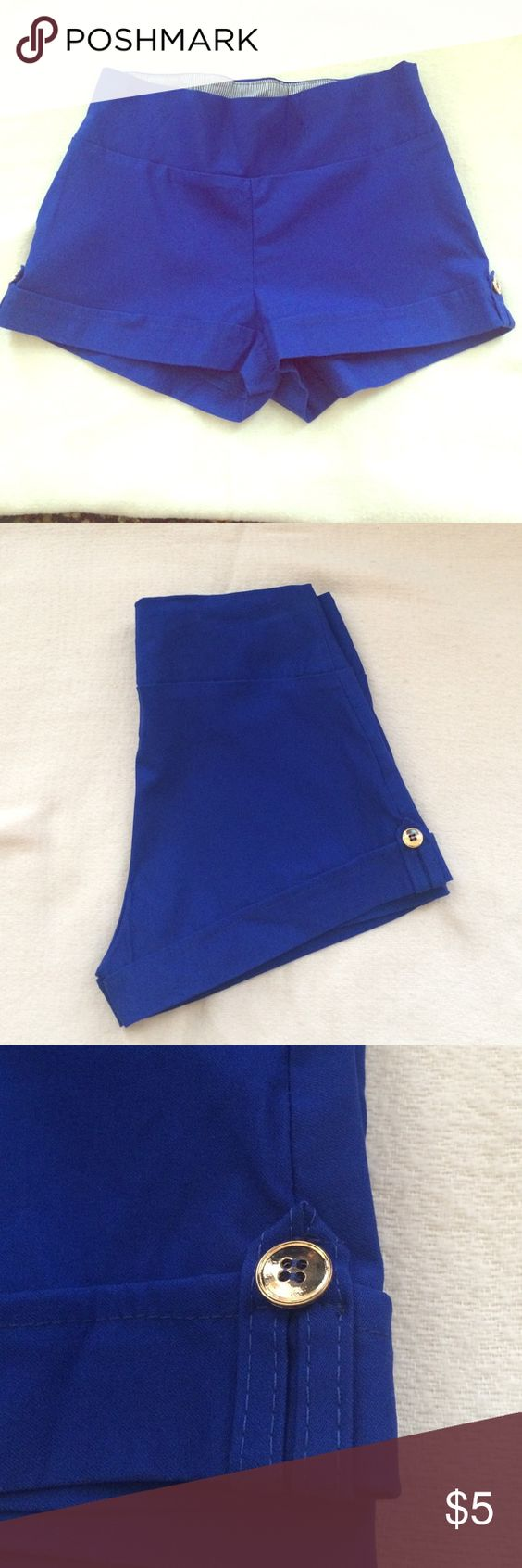 Stretchy shorts Adorable deep blue stretchy shorts with a button embellishment on the side of each leg. Wide waist band w/ a faux cuff at the legs. Size: Med Shorts