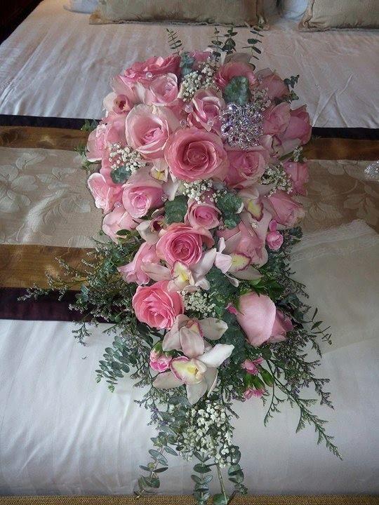 Bridal Bouquets By Dangwa Florist Wedding Bouquet Bridal Bouquet Wedding Flower Arrangement Cascading Bouq Wedding Flowers Flower Arrangements Pink Bouquet