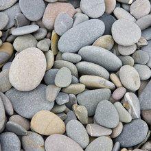 Fototapete - Pebbles on Sandymouth Beach