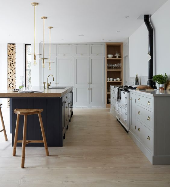 Farmhouse kitchen with cabinets painted in Pavilion Gray estate eggshell by Farrow & Ball. These are Workstead pendants from Trouva. #paviliongray #farrowandballpaviliongray #farmhousekitchen #greycabinets #graykitchen