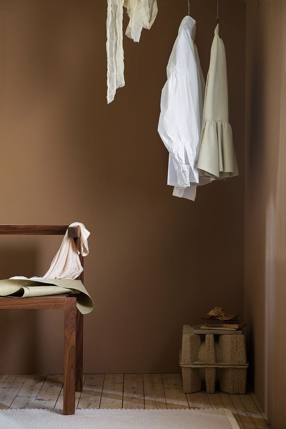 Hanging clothes rail as a part of the bedroom. Neutral coloured room with paint from Jotun Lady. See more on Hege in France - Scandinavian Interiors Blog.