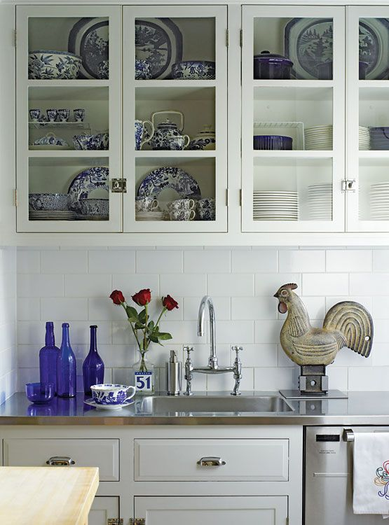 Love this!  What a great way to display special pieces that you use frequently in a cabinet with glass doors.