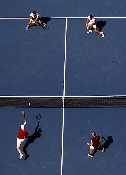 Jamie Murray of Great Britain and Bruno Soares of Brazil return a shot to Pablo…