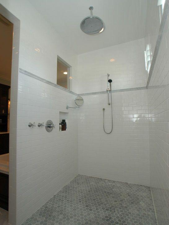 White subway tile bathroom with pebble flooring tile for Bathroom tile inspiration