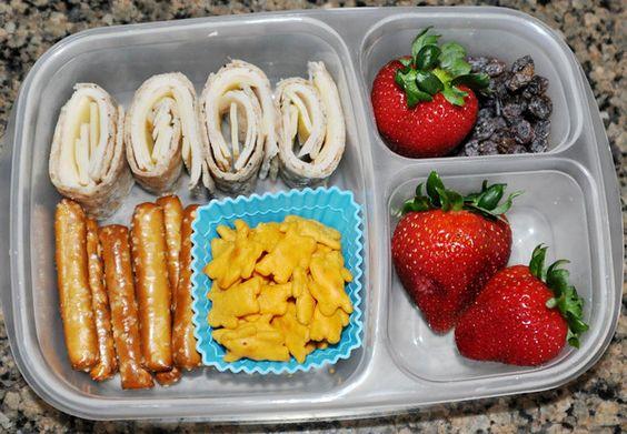 Turkey and cheese roll ups on a multigrain tortilla, pretzel rods, chedder bunnies, strawberries and raisins.