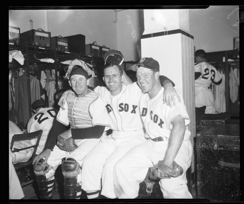 Red Sox players, including Birdie Tebbets, in clubhouse at Fenway Park